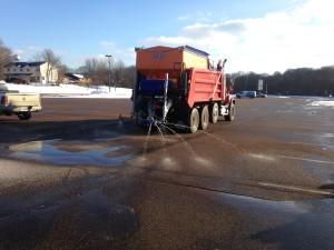 Truck applying liquid brine